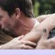 man kissing a lady in a hug