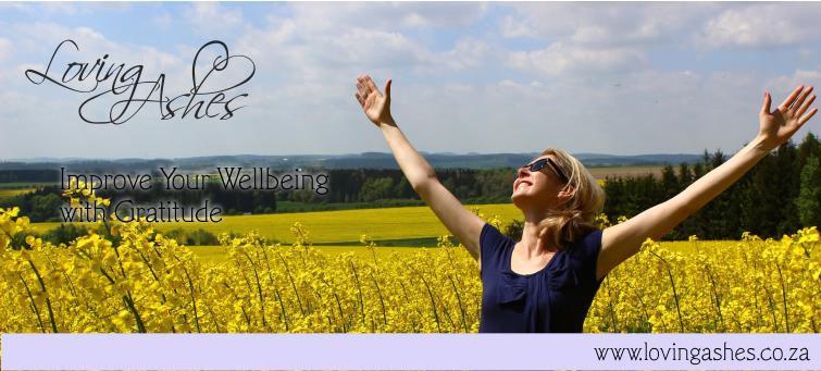 lady standing in field of flowers happy