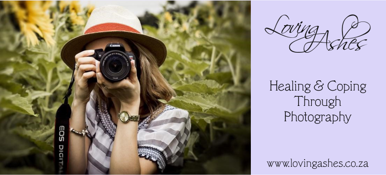 Female photographer taking a photo in a sunflower field